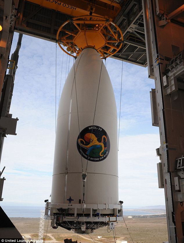 Creepy? The spy rocket launched on Thursday featured a logo with an angry octopus encircling the globe and the phrase: 'Nothing Is Beyond Our Reach.'