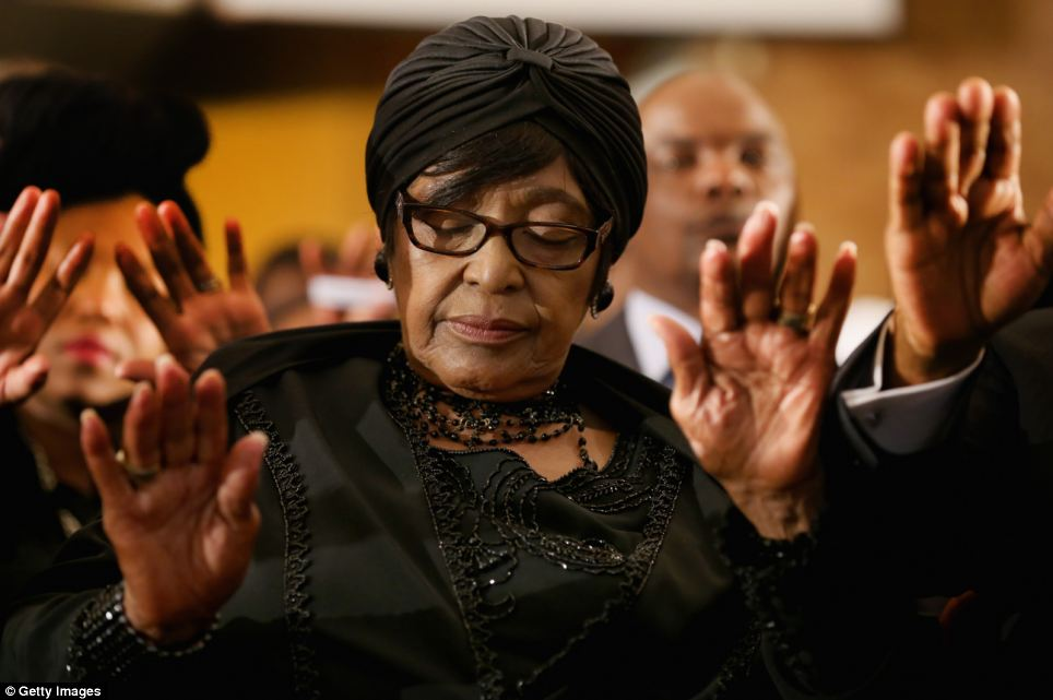 Winnie Madikizela-Mandela, ex-wife of former South Africa president Nelson Mandela prays as she attends a service at Bryanston Methodist Church