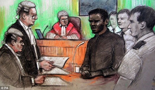 Evidence: Woolwich suspect Michael Adebolajo, who was surrounded in the dock by guards, today said he killed Lee Rigby because he is 'at war'