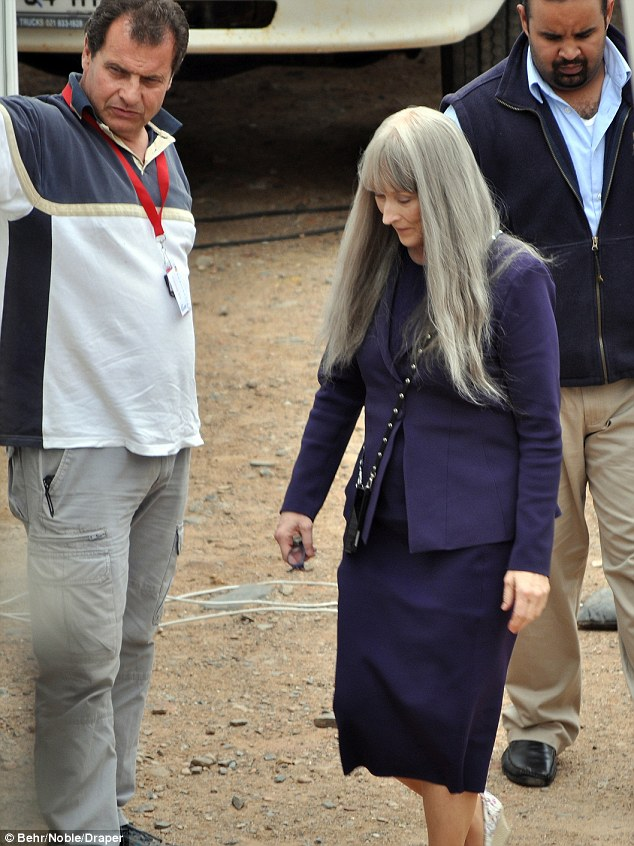 Wigging out: The three-time Oscar winner was all business in a purple skirt suit and white peep-toe wedges on the Cape Town set last Tuesday