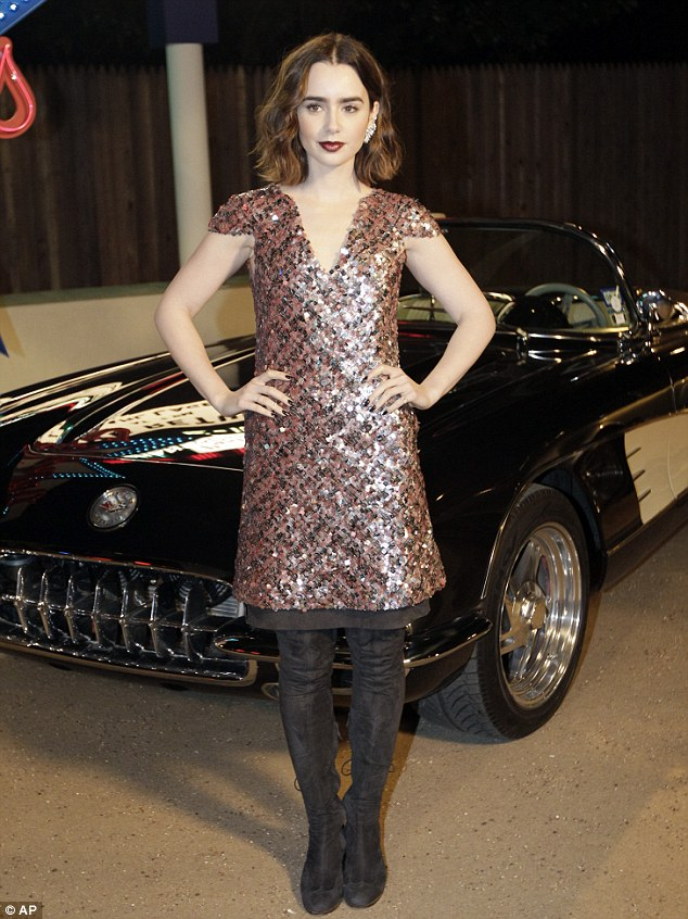 Chanel rebooted! Lily poses in front of a classic 50s sportscar in her cute but classic designer outfit from the legendary French fashion house