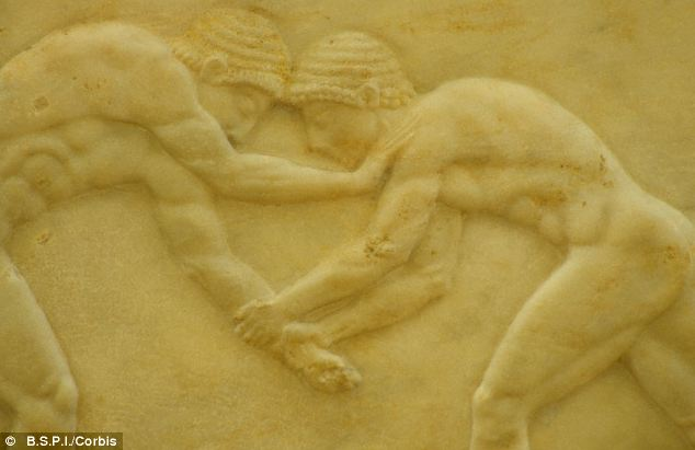 A carved marble relief of wrestlers