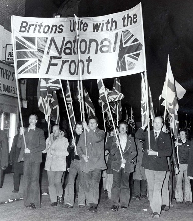 Extremist: National Front members march in London in 1975. The party wants all non-white immigrants deported