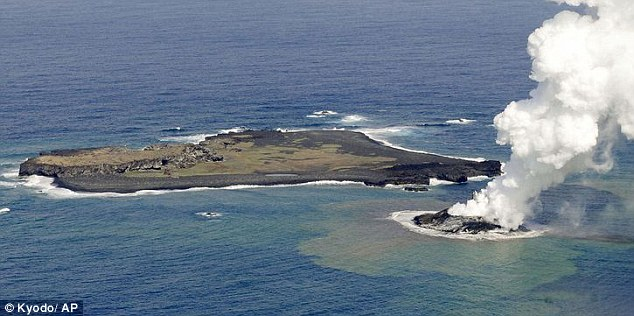 Violent birth: This image shows the newly formed Niijima island (right) next to the uninhabited Nishino Shima land mass, a day after it first emerged from the sea off the coast of Japan around 600 miles south of Tokyo