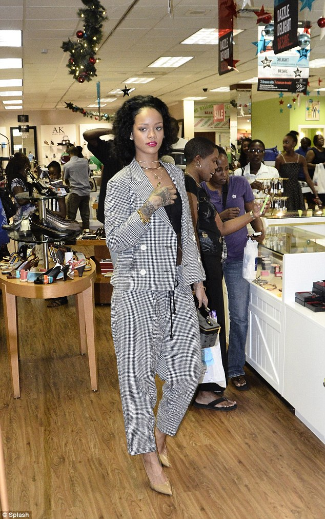Splashing out: The stunning star picked up a vanity case and a soft toy during her spree