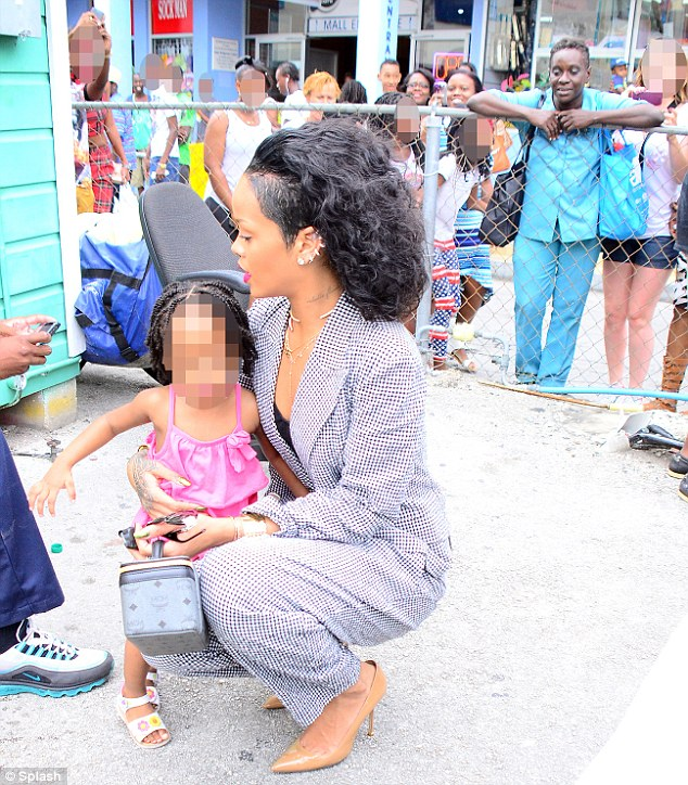 She's so kind: The star stopped to cuddle a cute little girl