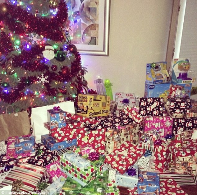 A huge haul: Earlier in the day, the curvy star shared a snap of the family's Christmas tree. Nestled underneath were dozens of gifts for the family