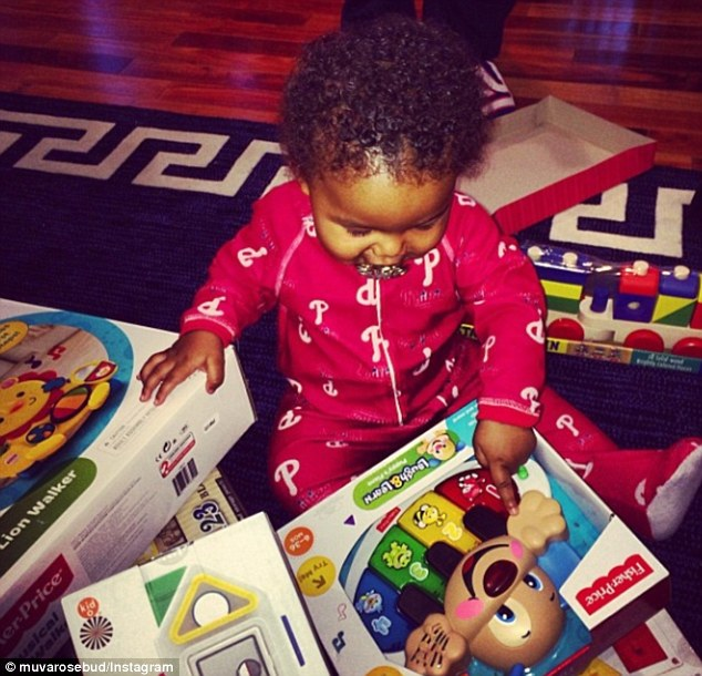 Baby's first Christmas! Amber Rose shared a snap of her son Sebastian opening presents on Christmas Day on Wednesday morning