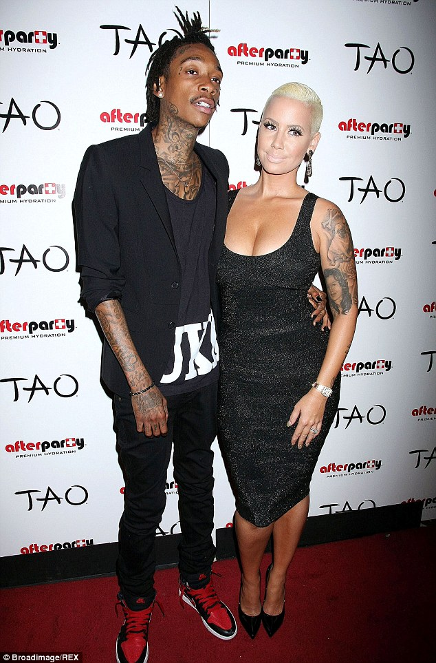 So in love:  Amber and her husband rapper Wiz Khalifa got married in July this year after Amber gave birth to their son in February