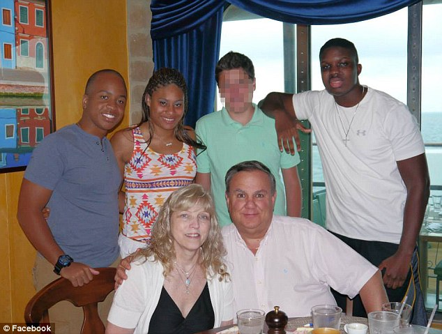 Close-knit family: Robert and Theresa Gallo (sitting front) adopted Teia (second from left) and Travis (right) when they were young