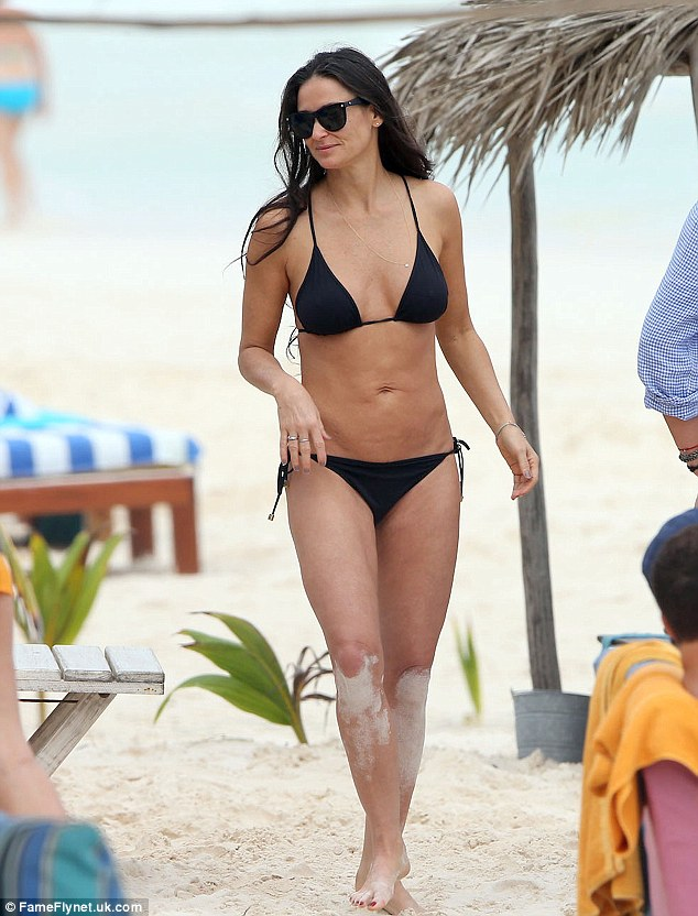 Damn Demi! The actress showed off her flawless body on the beach in a simple black bikini