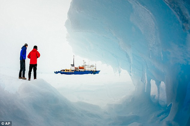 Keeping themselves busy: Passengers from MV Akademik Shokalskiy walk around the ice in the Antarctic
