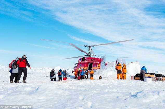 The end is in sight: The first of the 52 passengers on a research ship trapped in Antarctic ice for more than a week finally make their way to a rescue helicopter after several aborted attempts to evacuate them