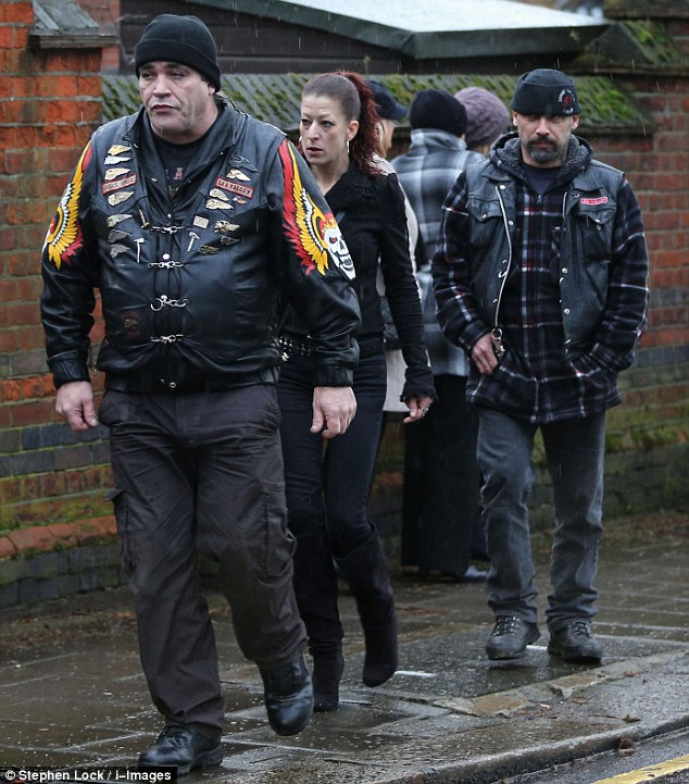 Mourners: Dressed in black, these people arrive at Ronnie Biggs' funeral in Golders Green this afternoon