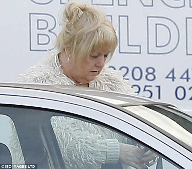 Mourner: Charmain Powell, the ex-wife of Ronnie Biggs, makes her way to his funeral in north London today