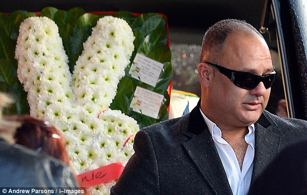 Grief: Michael Biggs, the Great Train Robber's son, is seen in sunglasses at the funeral in north London