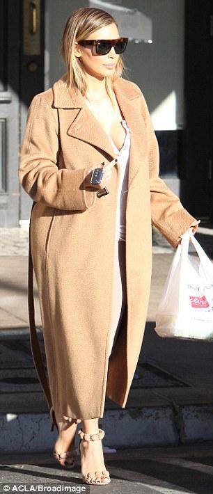 Kim Kardashian narrowly avoids wardrobe malfunction in low