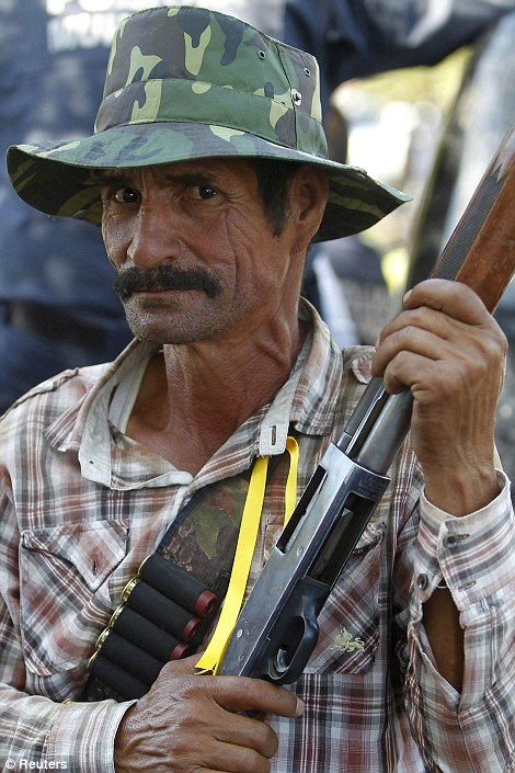 Local vigilantes took up arms to seize back control of Paracuaro from criminal gang members