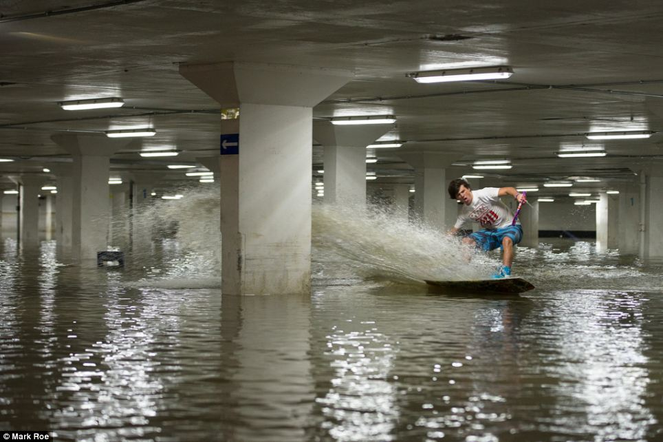 Watch daredevils use flooded carpark as wakeboarding