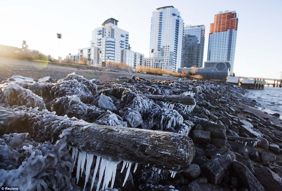 Ice forms on the shore of the East River due to unusually low temperatures caused by a polar vortex in New York on Tuesday
