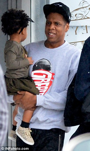 Having a chat: Blue was seen chatting happily away to her father as he carried her along
