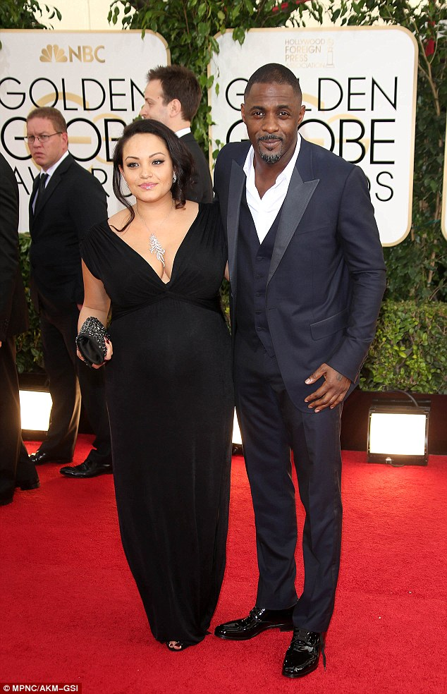 Red carpet: Idris and his pregnant girlfriend pose at the Beverly Hilton Hotel for the annual ceremony
