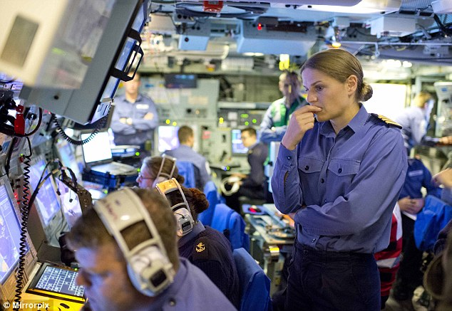 Commander West oversees the hunt for the submarine in the ship's operations room.