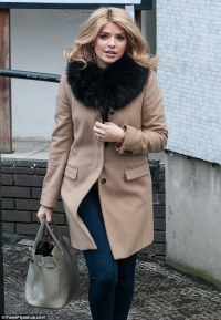 Holly Willoughby looks chic in camel coat after filming ...
