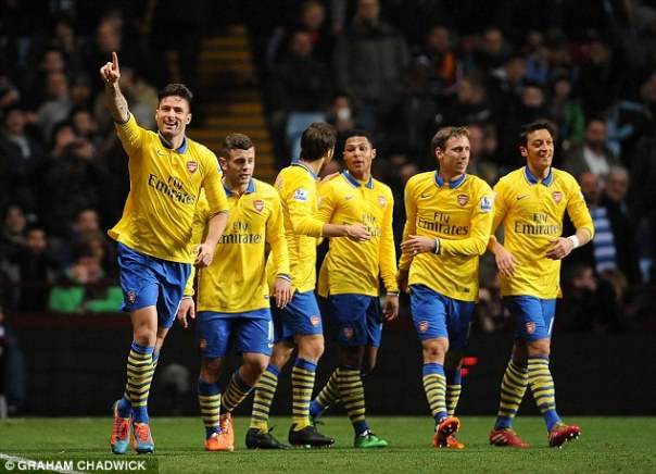All smiles: Olivier Giroud and his Arsenal team-mates celebrate after he scored the second