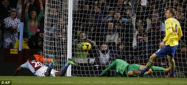 Well taken: Christian Benteke dives in at the far post for Aston Villa's goal