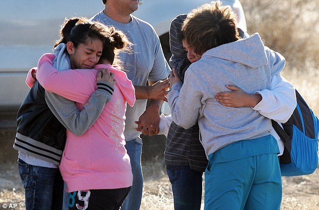Tears: Students are reunited with family following a shooting at Berrendo Middle School, Tuesday, January 14, 2014