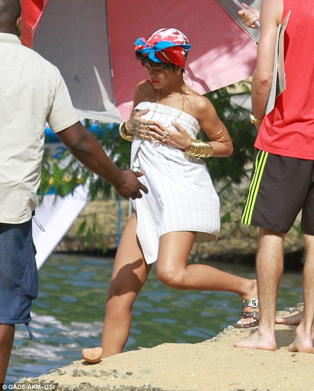 Quick change: Hard-working Ri-Ri darted between locations in a towel and sandals