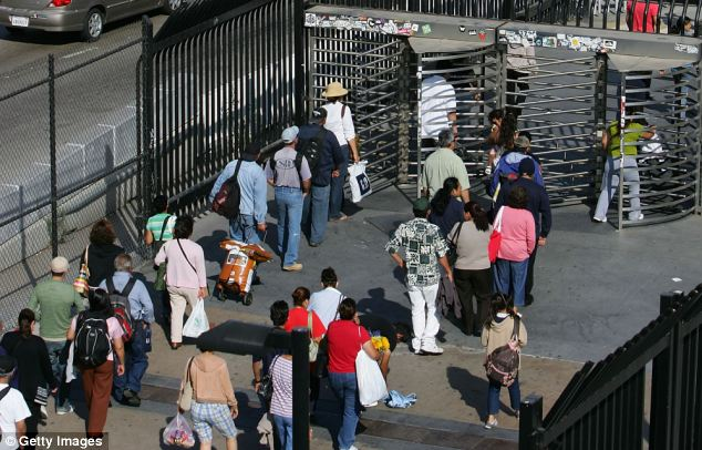 Scene: Traffic and pedestrians are pictured at the San Ysidro border crossing, the world's busiest