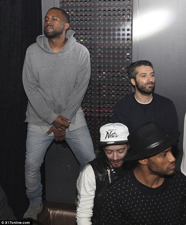 baseball leather sofa s shaped springs kanye west ditches kim kardashian for a parisian club ...