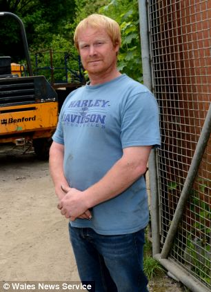 Andrew Woodhouse, 44, was today on trial accused of assaulting two raiders he found stealing diesel from his business