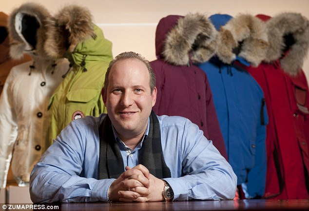 Real fur real suffering: Canada Goose President Dani Reese flanked by his company's distinctive outerwear. He says the company uses Coyote fur 'because it works'