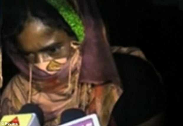 Abhorrent: The 20-year-old woman, pictured arriving at a hospital in Western Bengal, was discovered with a man of another religion and was dragged to a 'village court' where elders sentenced her to be gang raped