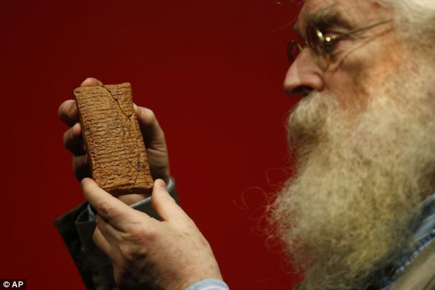 Irving Finkel, curator in charge of cuneiform clay tablets at the British Museum, poses with the 4000 year old clay tablet containing the story of the Ark and the flood.
