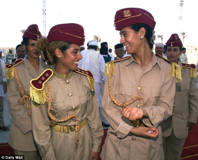Coerced: Gaddafi had a private all-female guard, some of whom he allegedly also abused, having 'selected' them from schools and universities across the country (file picture)