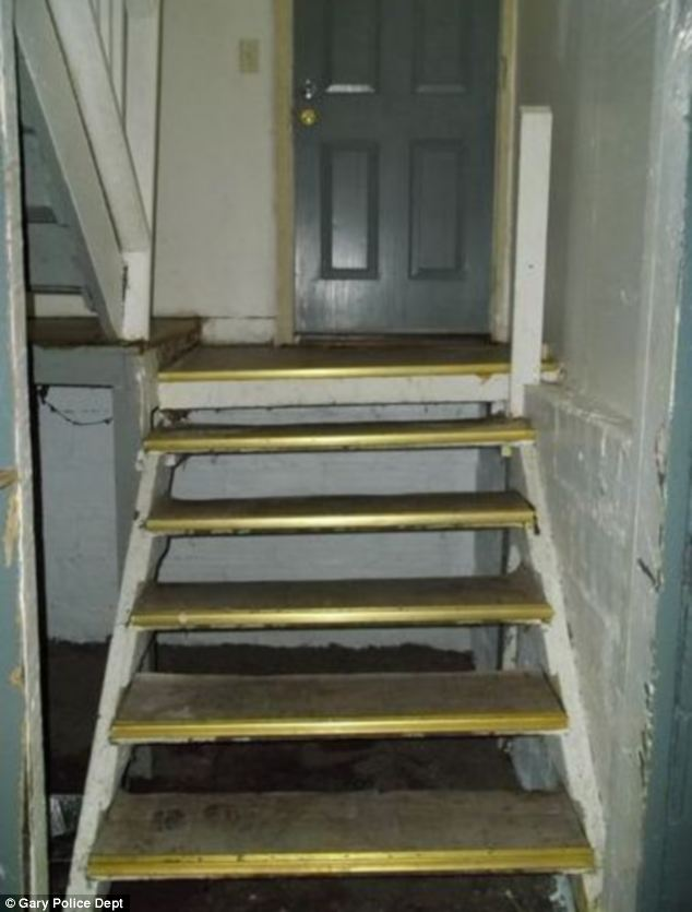 Activity: Most of the problems at the home were around the basement stairs, pictured. Police dug a four foot hole under the stairs to look for graves