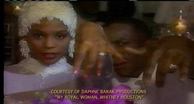 Hand in hand: Whitney Houston and new husband Bobby brown show off  their wedding rings after tying the knot on July 18, 1992