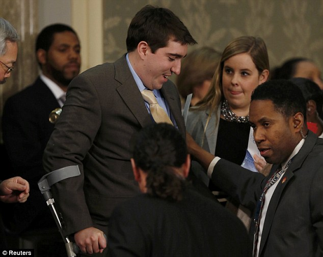 Survivor: Boston Marathon bombing survivor Jeff Bauman, who had to have both his legs amputated after being injured in the blasts, arrives before the start of U.S. President Barack Obama's State of the Union speech