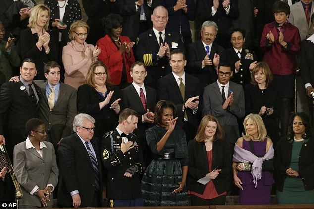 First Lady Michelle Obama waves from her box before President Barack Obama's State of the Union address on Capitol Hill in Washington