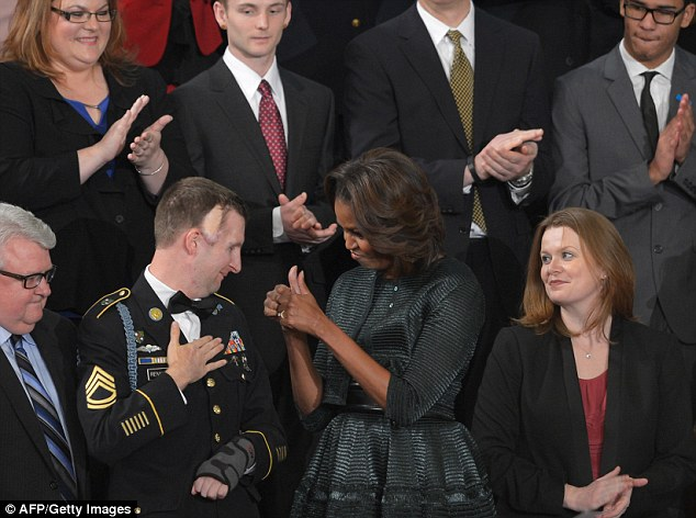 Tribute: US First Lady Michelle Obama gives the thumbs up to US Army Ranger Cory Remsburg, who was wounded in Afghanistan during President Obama's State of the Union address