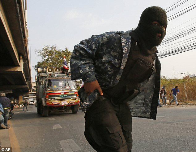 Masked: Many of the gunmen were wearing balaclavas to hide their identities as they sought to disrupt the election