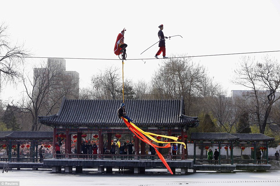 Acrobats perform on a tightrope at a temple fair celebrating the traditional Chinese Spring Festival in Beijing