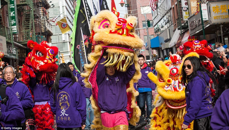 New York parade: Thousands of people braved the cold to celebrate Chinese New Year in Chinatown