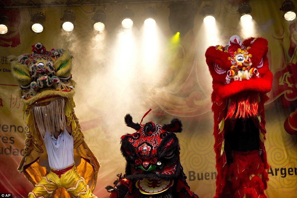 Buenos Aires: People perform in the Lions Parade during Chinese New Year. According the tradition, touching the dragon brings good luck