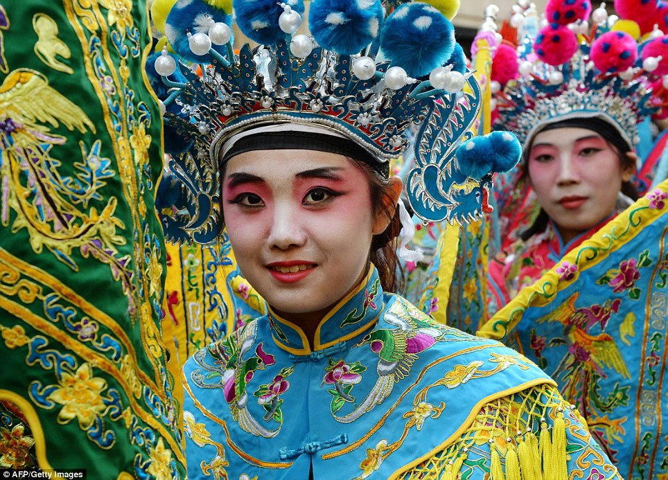 Paris festivities: People in costume parade through the French capital to mark the start of the Chinese lunar calendar