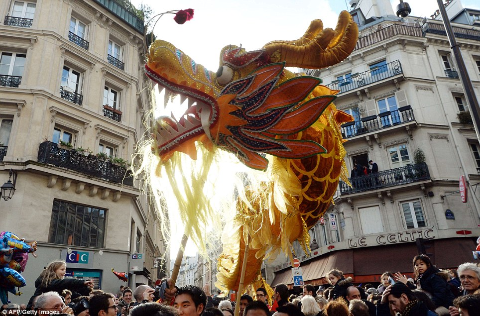 Crowds: Thousands turned out to watch the celebrations in Paris which featured the usual dragon and lion puppets as well as horses to mark the Year of the Horse